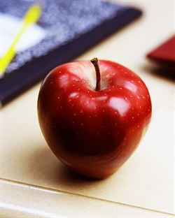 Image of an apple on a desk